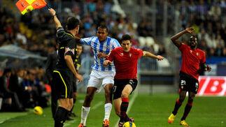El gol de Juanmi puso las tablas a un partido donde el Málaga lo hizo y deshizo todo.   Foto: AFP