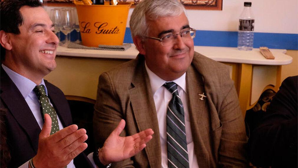 Juanma Moreno y Antonio Ramírez de Arellano.