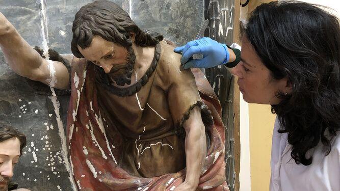 Encuentran la firma de Martínez Montañés en el retablo de San Juan Bautista de San Leandro